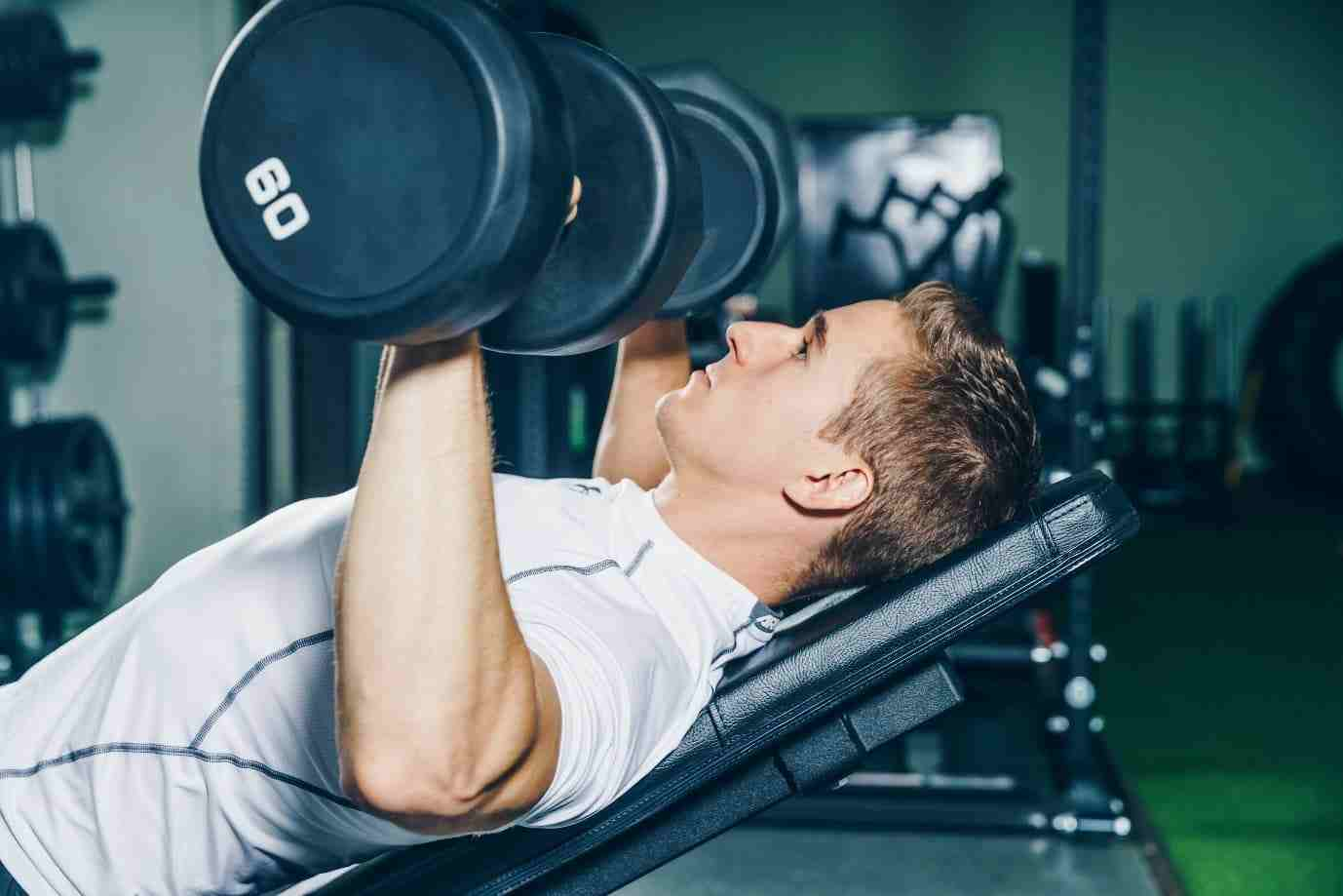 a man dumbbell training