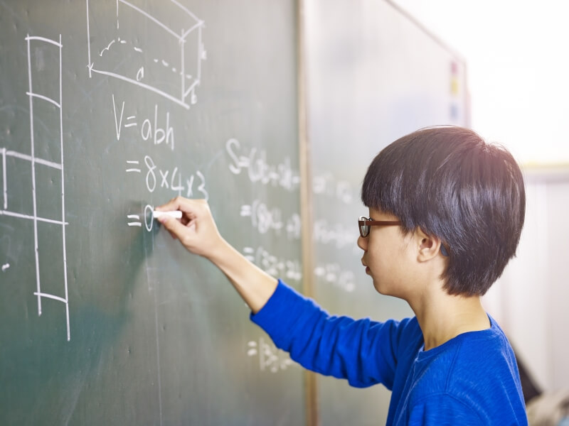 Stress management for kids – boy writing on a board