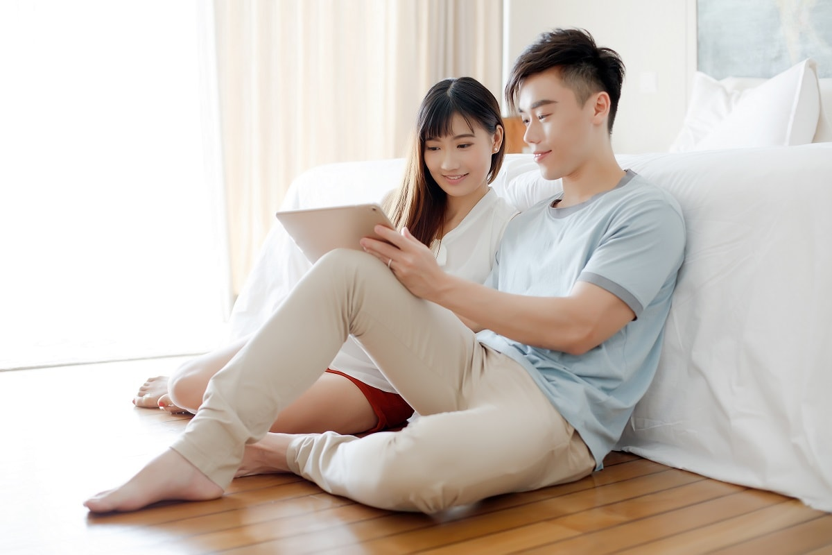 Young married couple browsing iPad – Financial Planning Tools